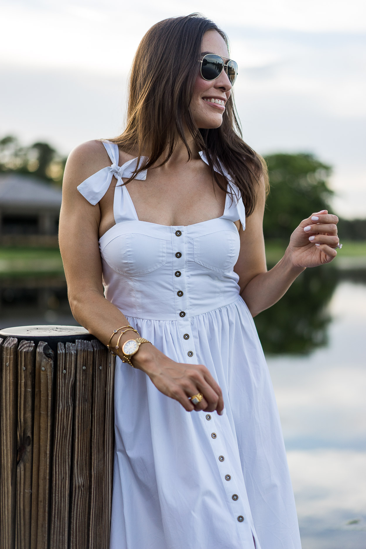 Style a Summer white dress like this Chicwish white cami dress worn by AGlamLifestyle blogger