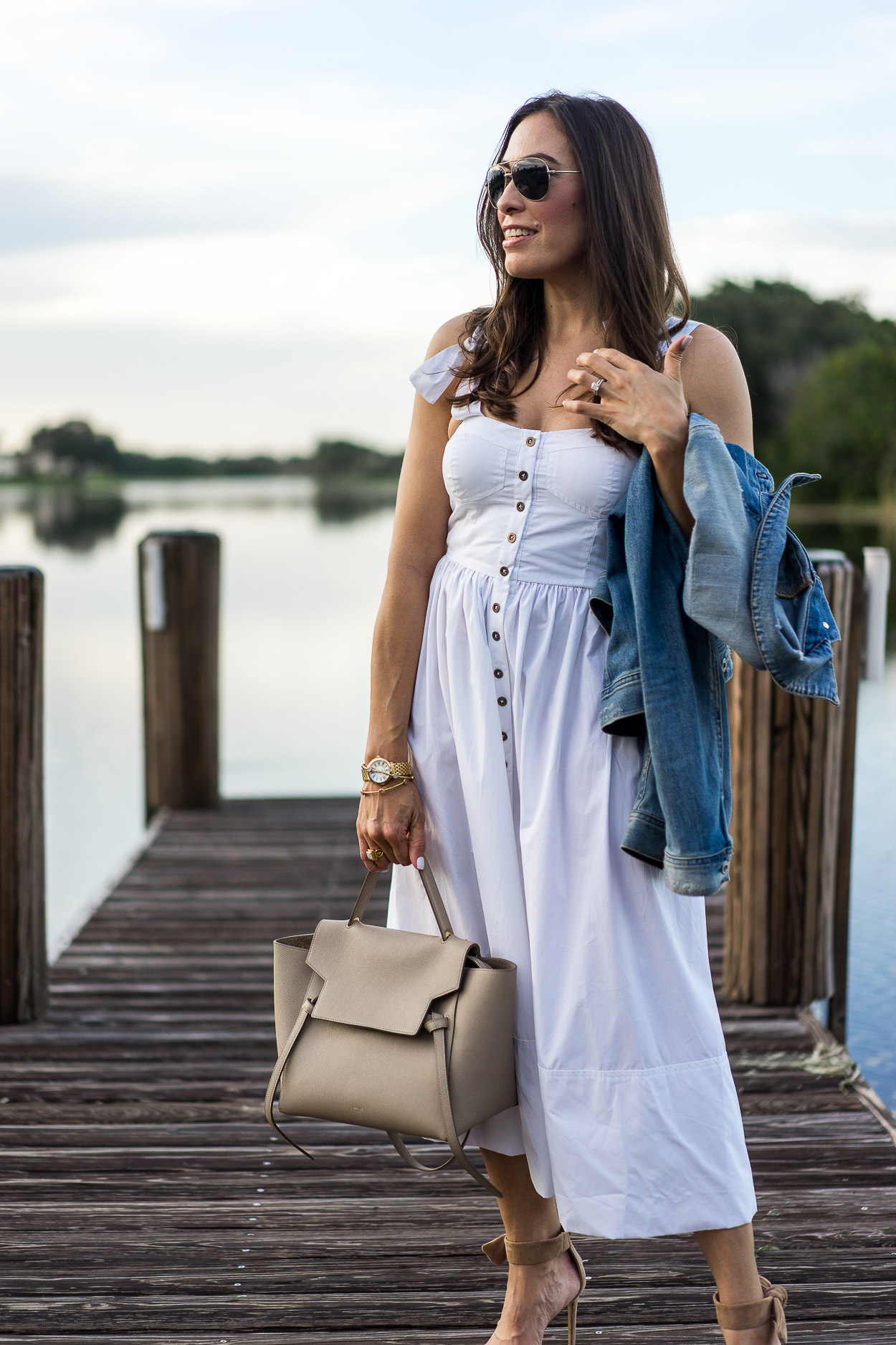 Chic Summer white dress worn by blogger Amanda of A Glam Lifestyle with Celine belt bag and AG Jeans denim jacket