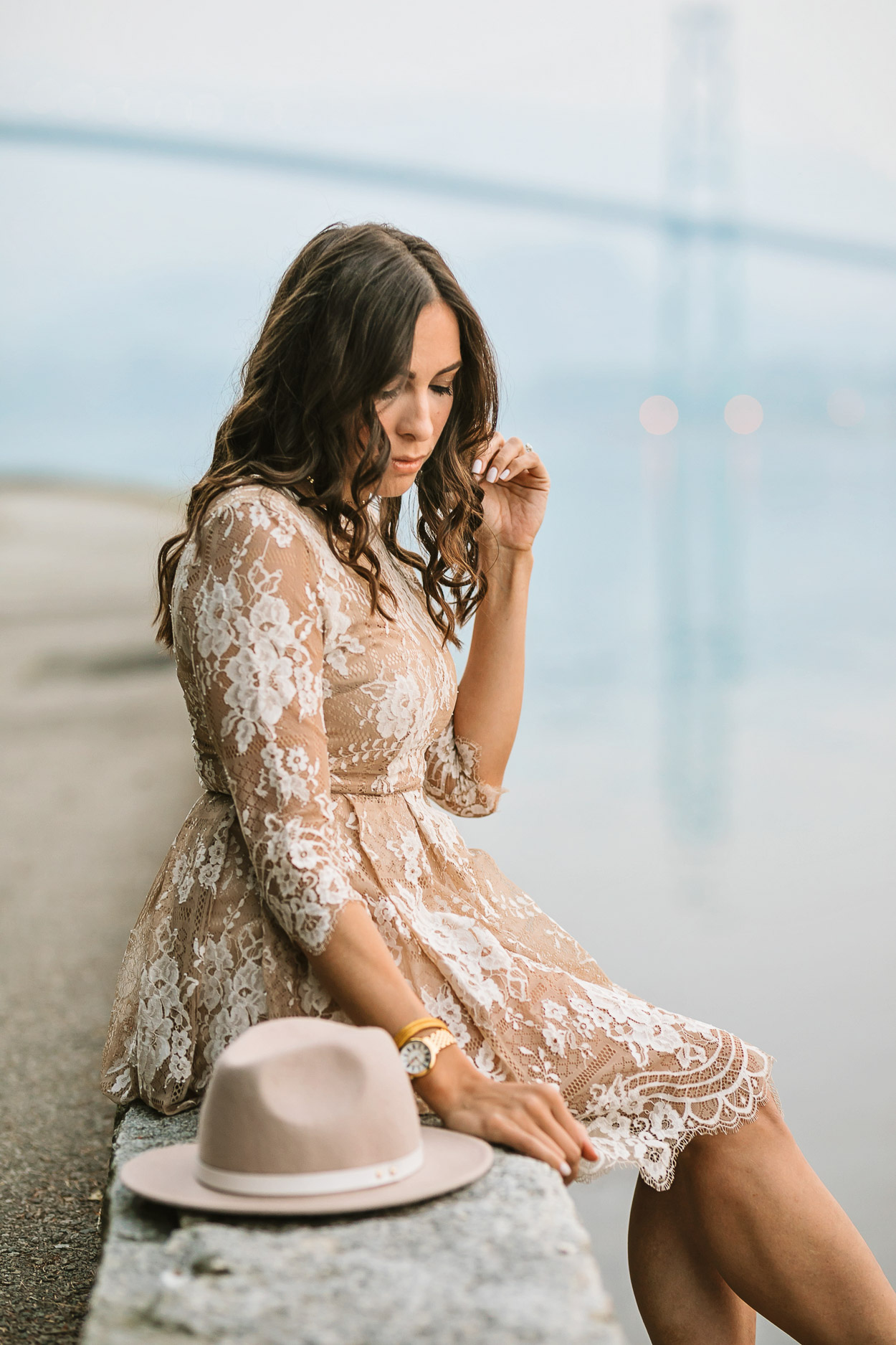 Blogger Amanda of A Glam Lifestyle wears Chicwish lace dress at Lions Gate bridge in Vancouver
