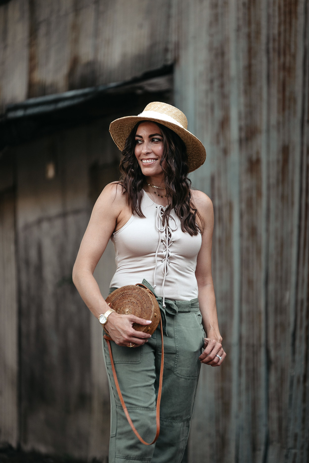 Nude lace up bodysuit is styled with tie waist cargo pants by fashion blogger Amanda of A Glam Lifestyle with round basket bag