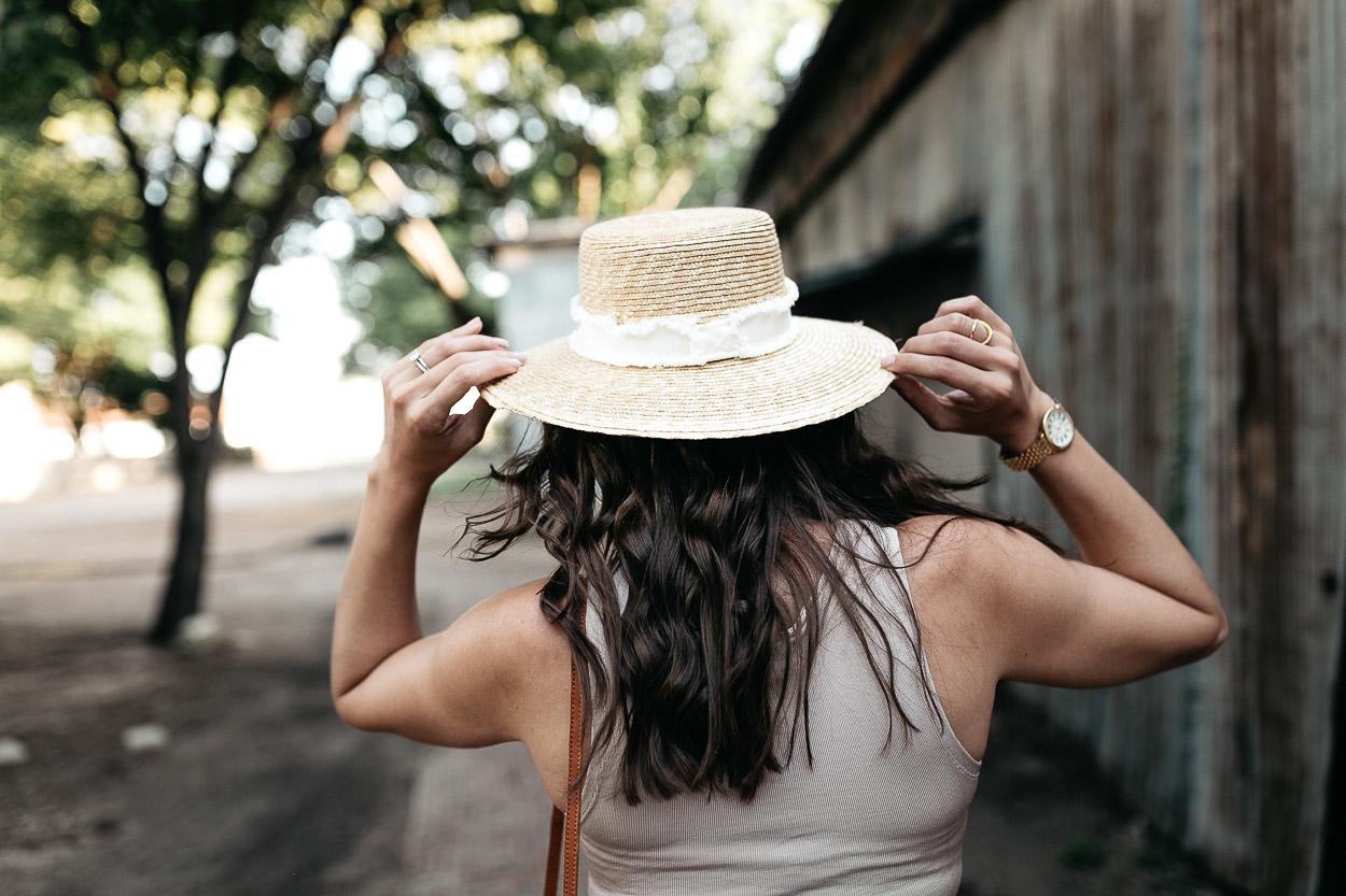 Amanda of A Glam Lifestyle blog grabs her Rag and Bone straw boater hat with her lace up bodysuit for hot Summer days
