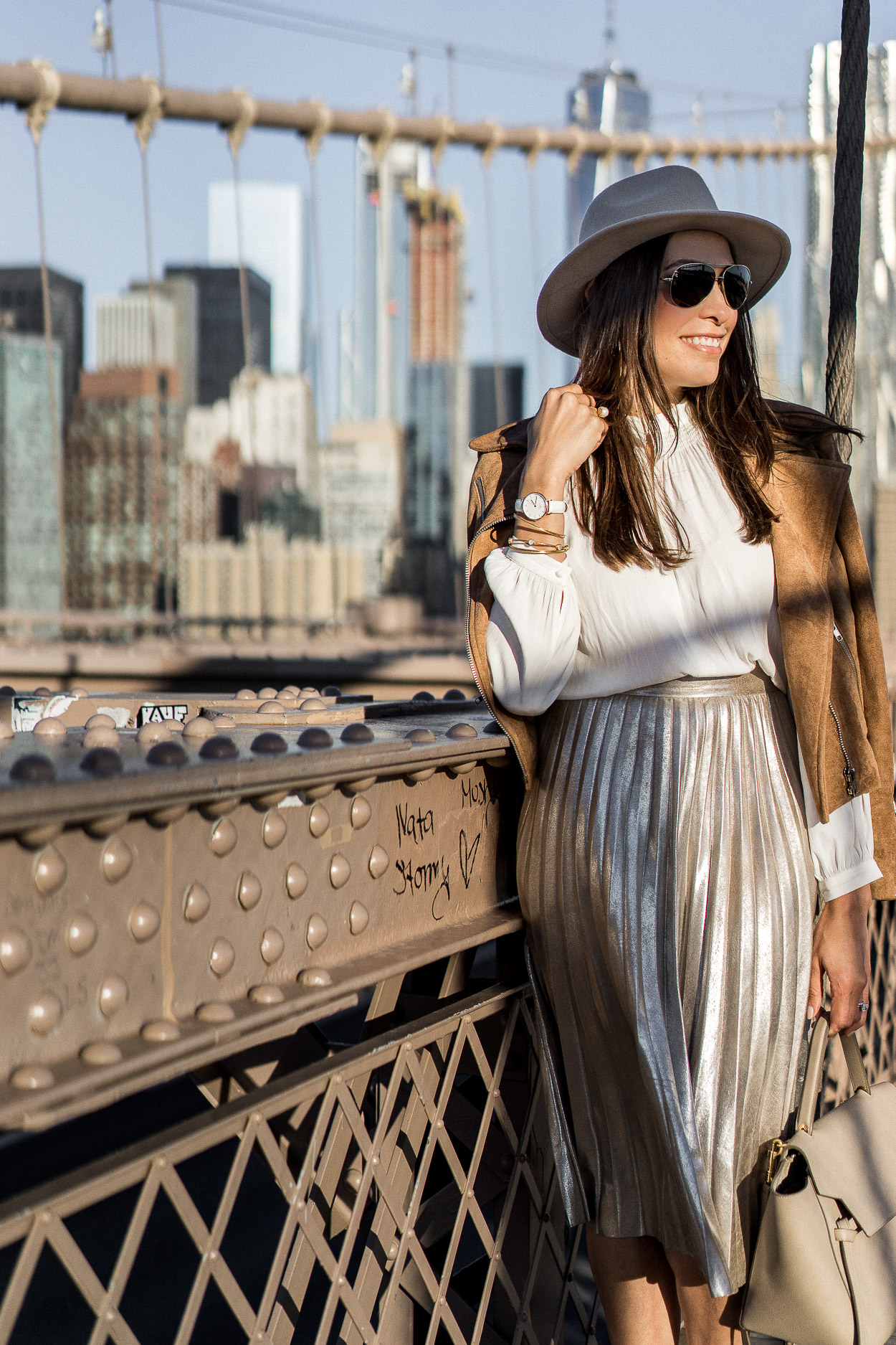 Mixing a metallic pleated skirt with neutrals makes for perfect Fall fashion shown by Amanda of A Glam Lifestyle blog