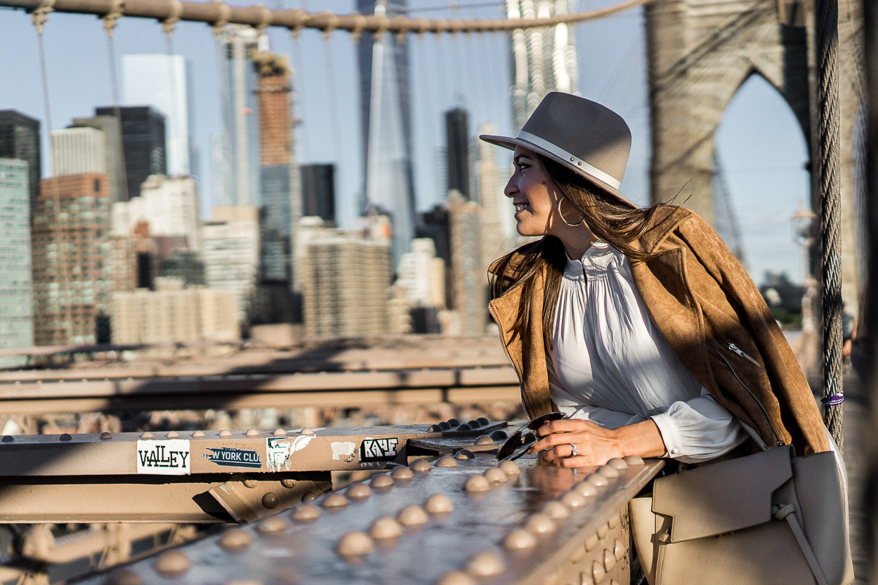 Fashion blogger A Glam Lifestyle takes in the NYC views during New York Fashion Week SS17 at the Brooklyn Bridge