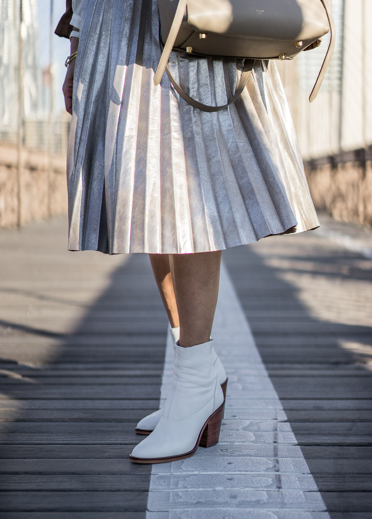 Pair your metallic pleated skirt with white sock booties from Topshop this Fall a la blogger Amanda from A Glam Lifestyle