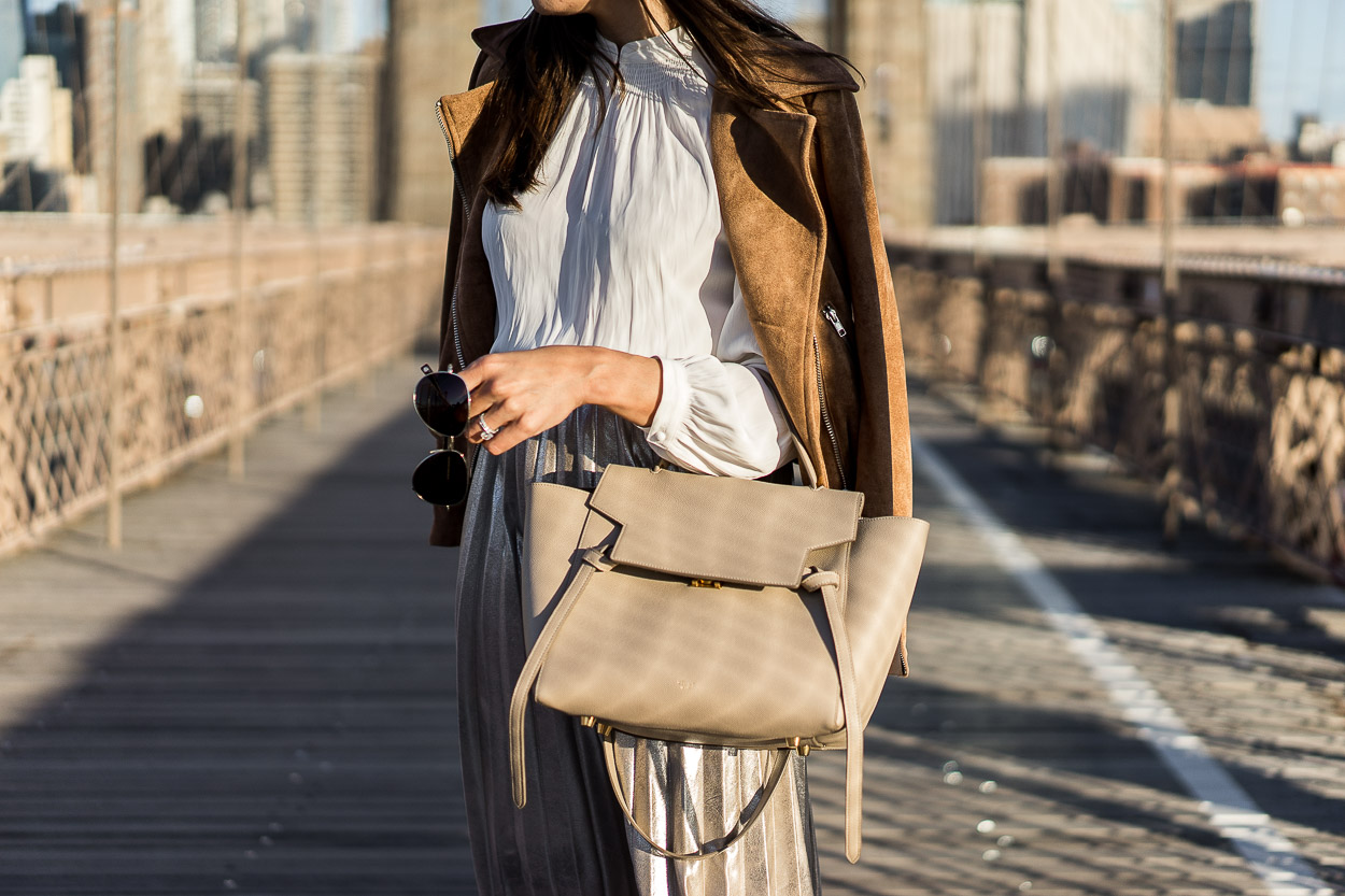 Neutral accessories pair well with a metallic pleated skirt for Fall's best fashion shown by AGlamLifestyle blogger Amanda