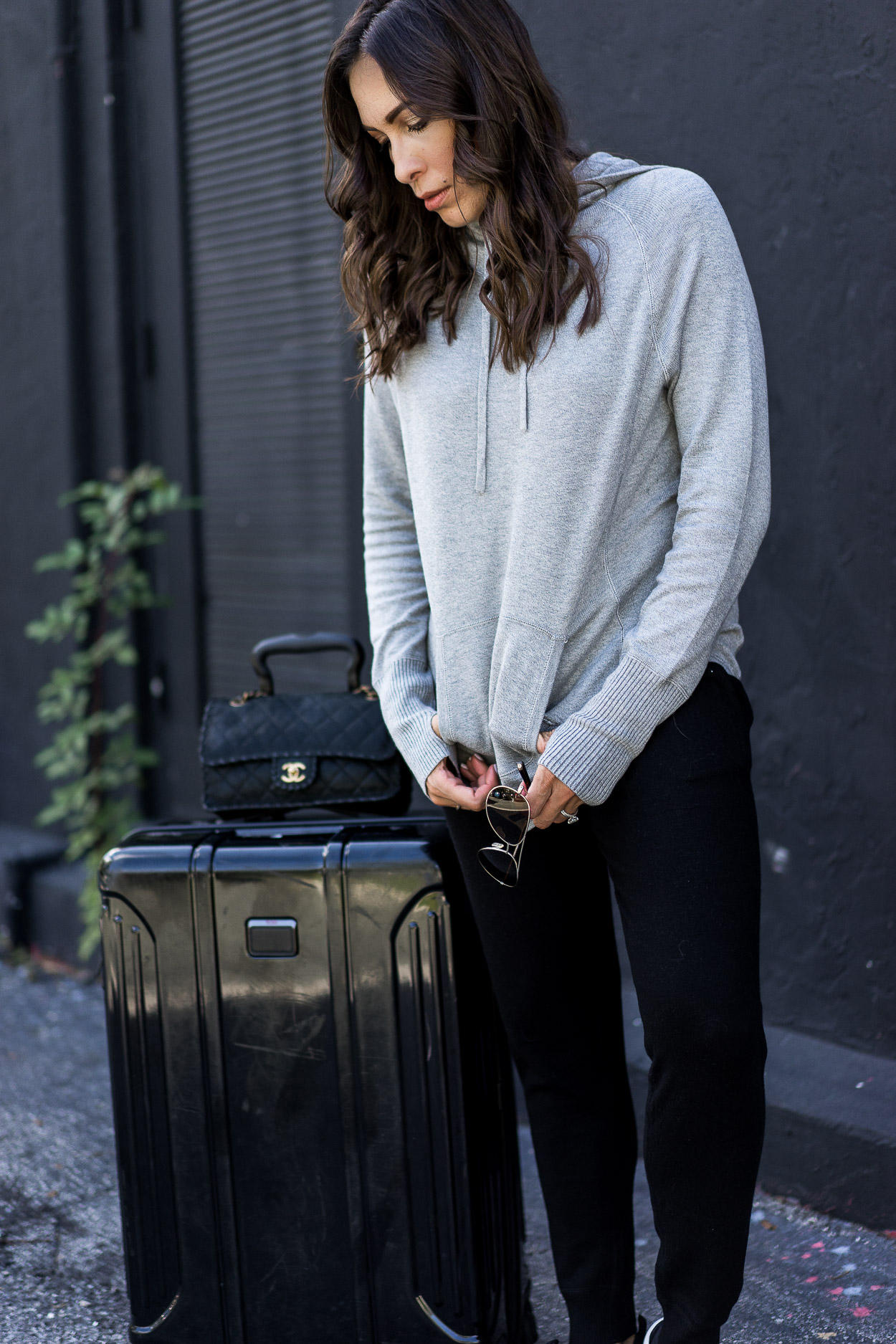 Leimere cashmere joggers are the ultimate travel style when paired with a cashmere hoodie - worn by blogger Amanda of A Glam Lifestyle