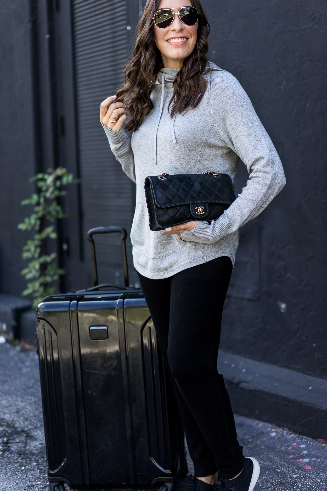 Travel in style in Leimere cashmere joggers and hoodie like blogger Amanda of A Glam Lifestyle