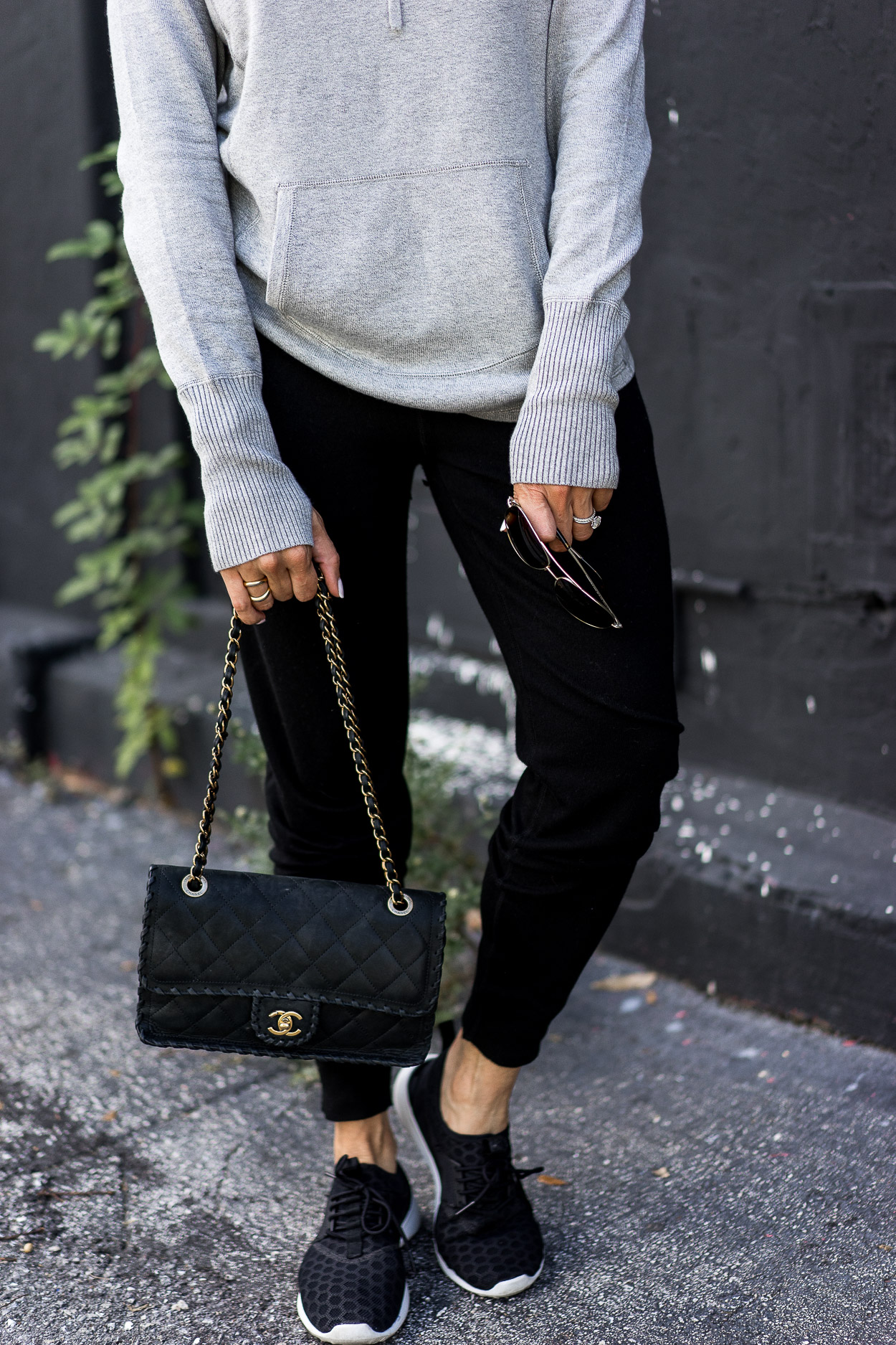 Leimere cashmere joggers review by A Glam Lifestyle blog who paired the affordable cashmere with her Chanel bag and Nike sneakers