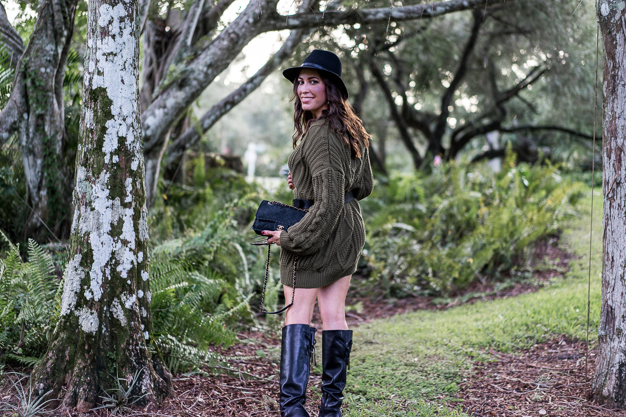 A Glam Lifestyle blogger wears Chicwish sweater dress with M Gemi boots and Gucci belt