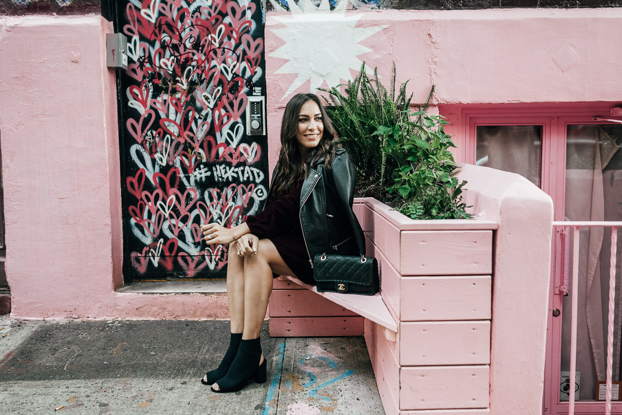 AGlamLifestyle blogger pairs velvet dress with black sock booties and Maje leather jacket for fall style