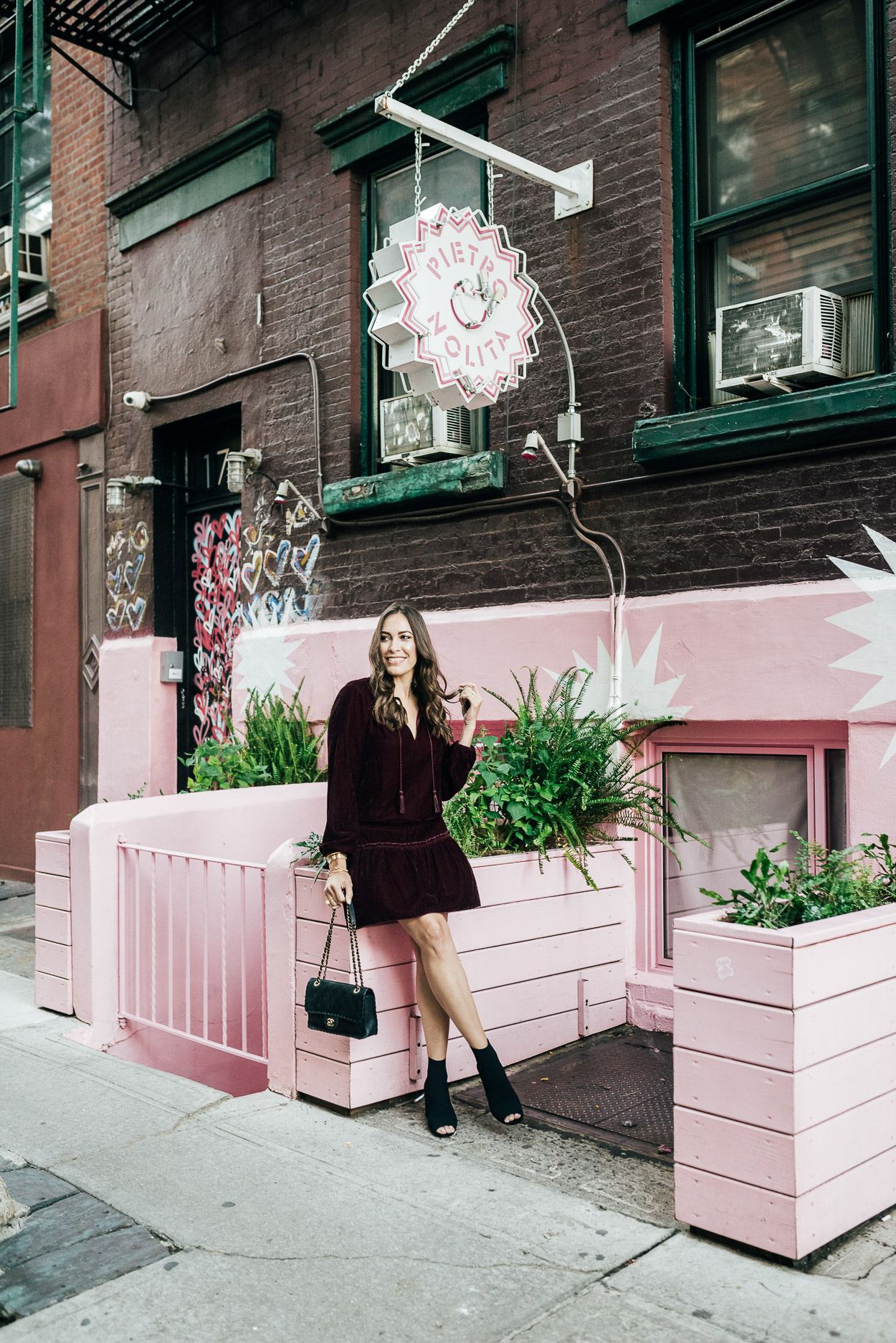 How to style a velvet dress shown by AGlamLifestyle blogger at Pietro Nolita in Soho