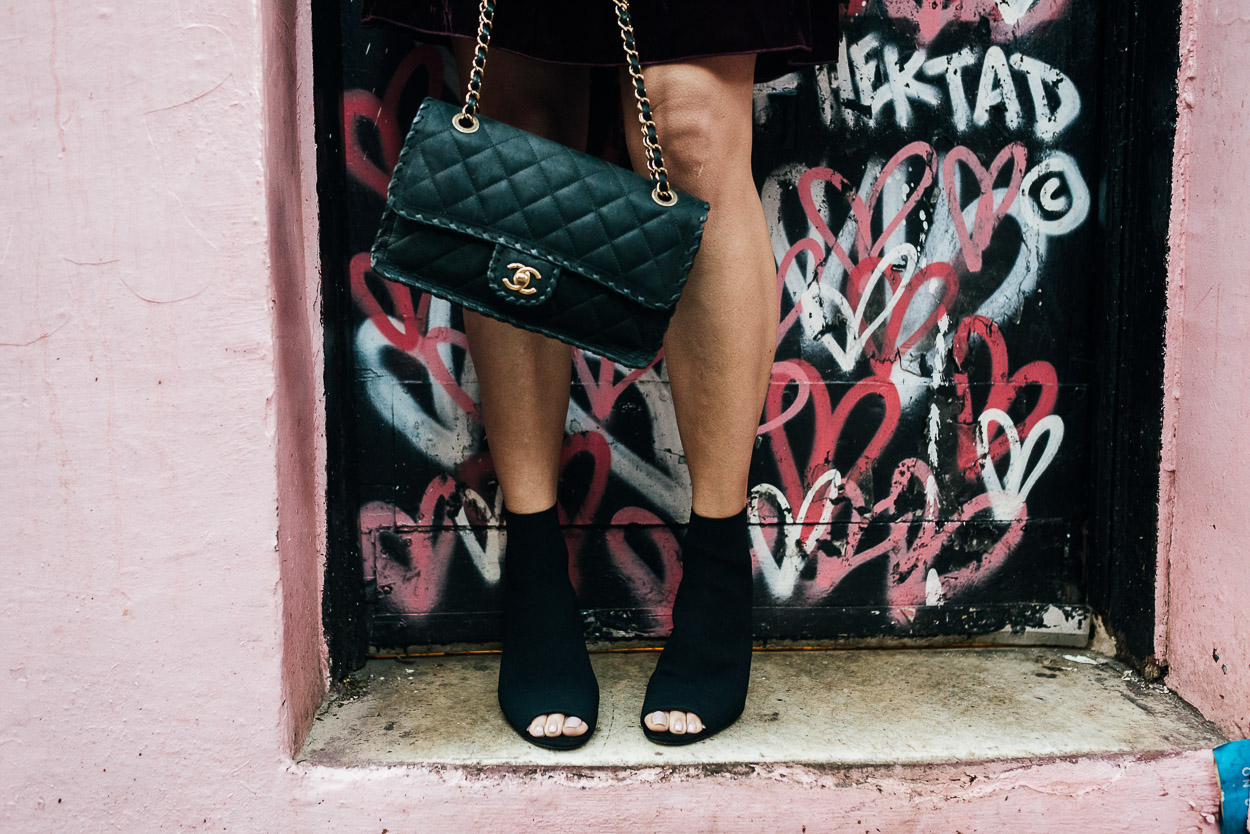 Classic black Chanel bag and black sock booties are staple Fall accessories for Amanda of A Glam Lifestyle blog