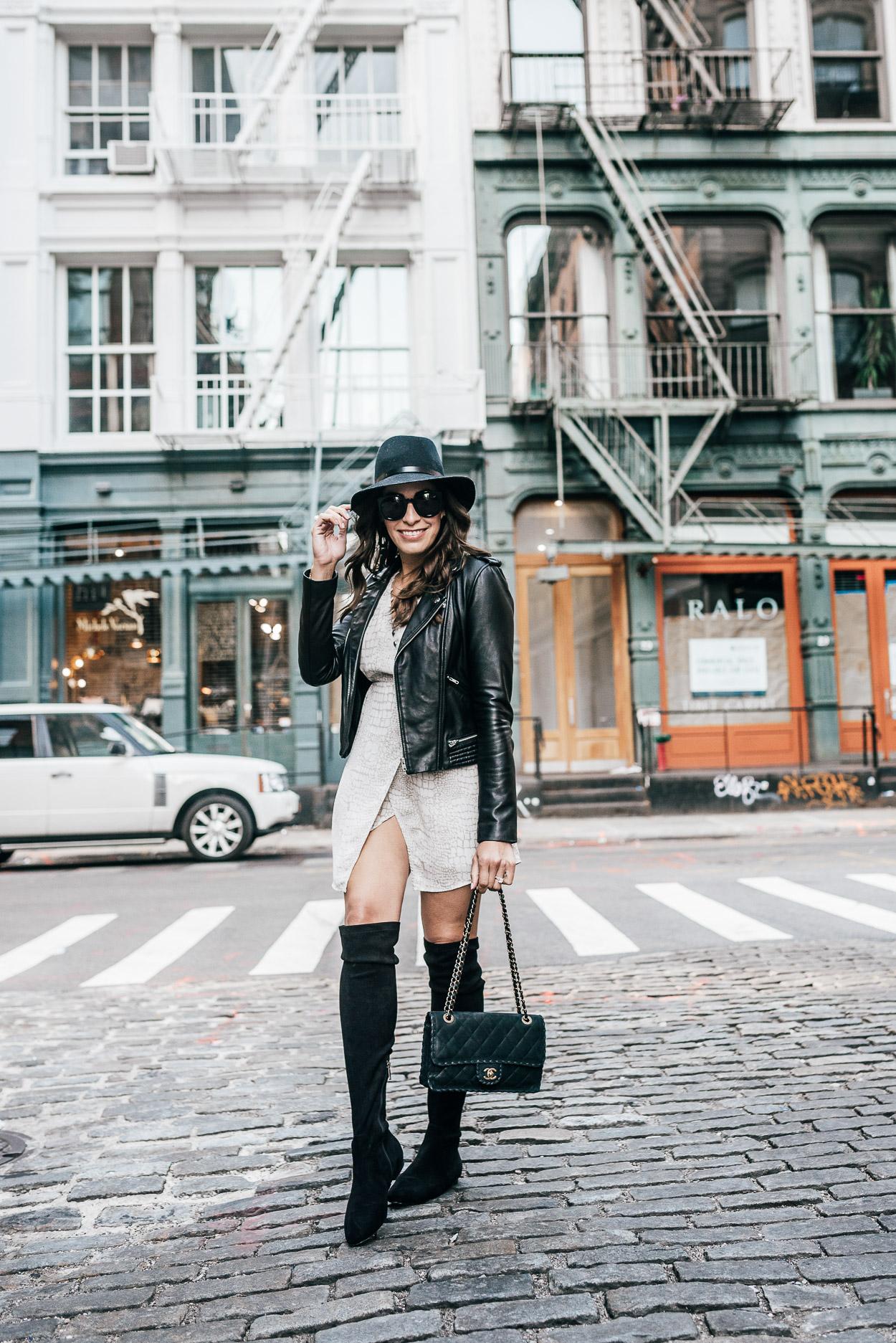 Gentle Fawn Elijah faux wrap dress is styled by AGlamLifestyle blogger Amanda with classic Chanel bag and Maje leather jacket during NYFW in Soho