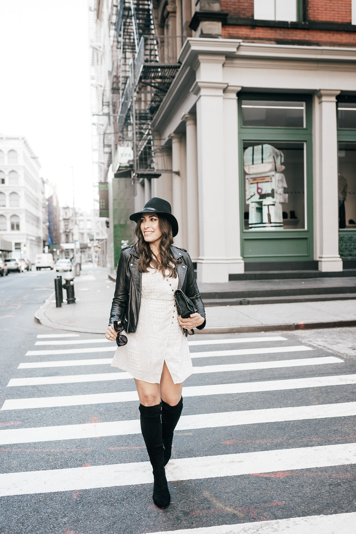 Gentle Fawn Elijah dress worn during NYFW by blogger Amanda of A Glam Lifestyle with Joie over the knee boots, Maje leather jacket and Rag and Bone felt fedora
