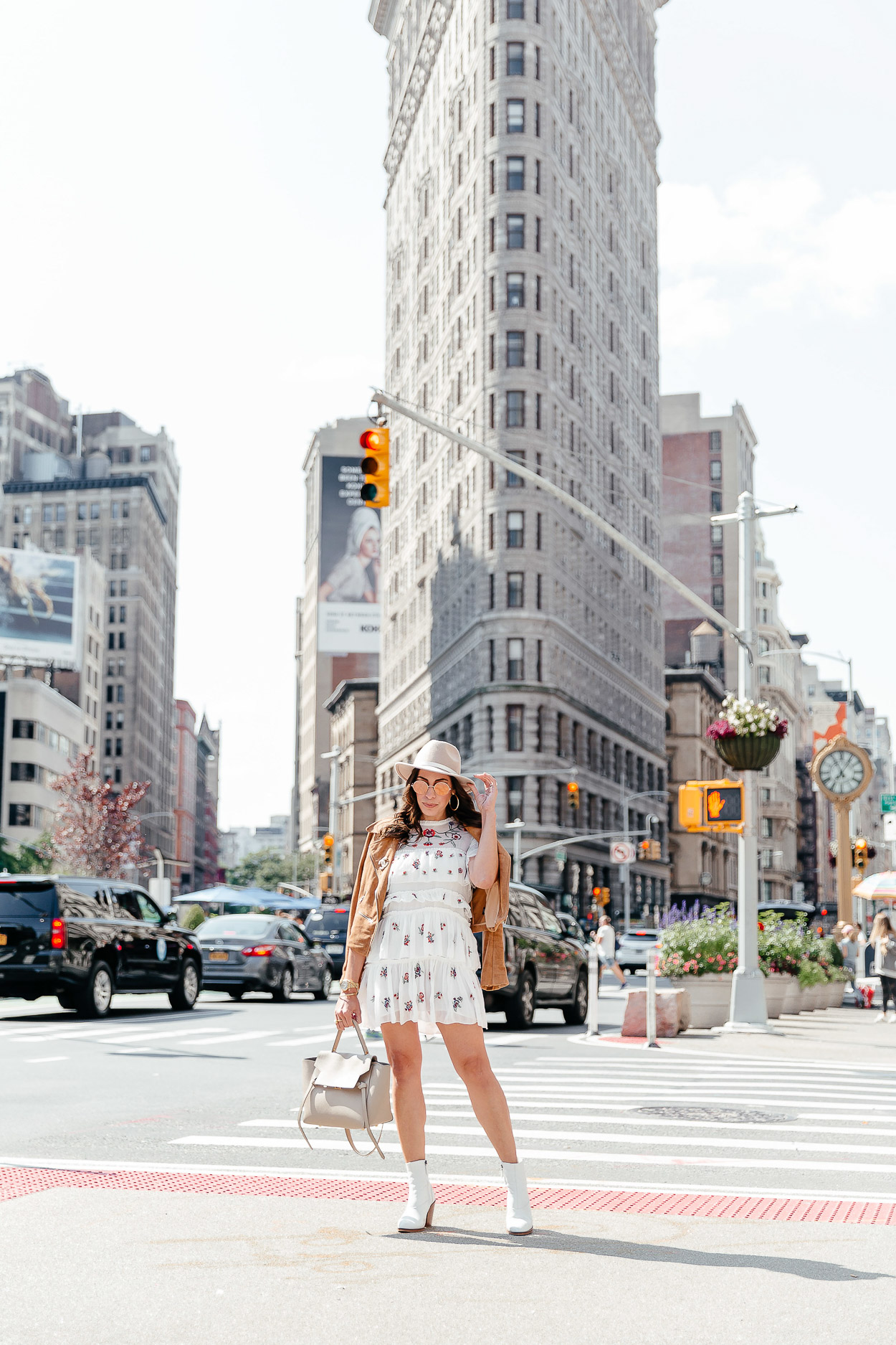 Bloggers wears Topshop white booties with Chicwish white dress and Celine belt bag for NYFW