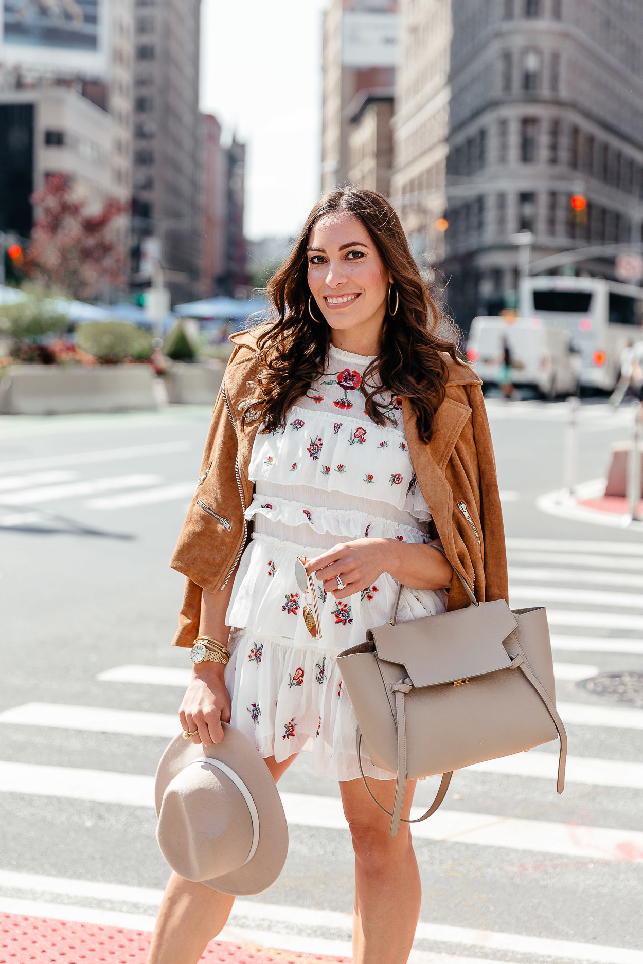 A Glam Lifestyle blogger wears Chicwish tiered floral dress with white booties and Celine belt bag