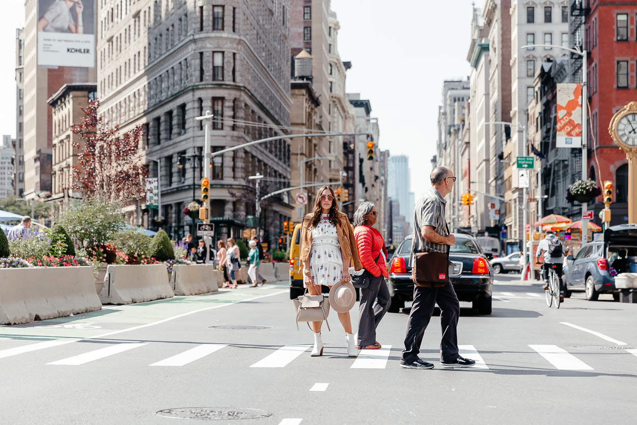 White booties and Chicwish dress stop traffic in the Flatiron district of NYC by blogger Amanda of A Glam Lifestyle