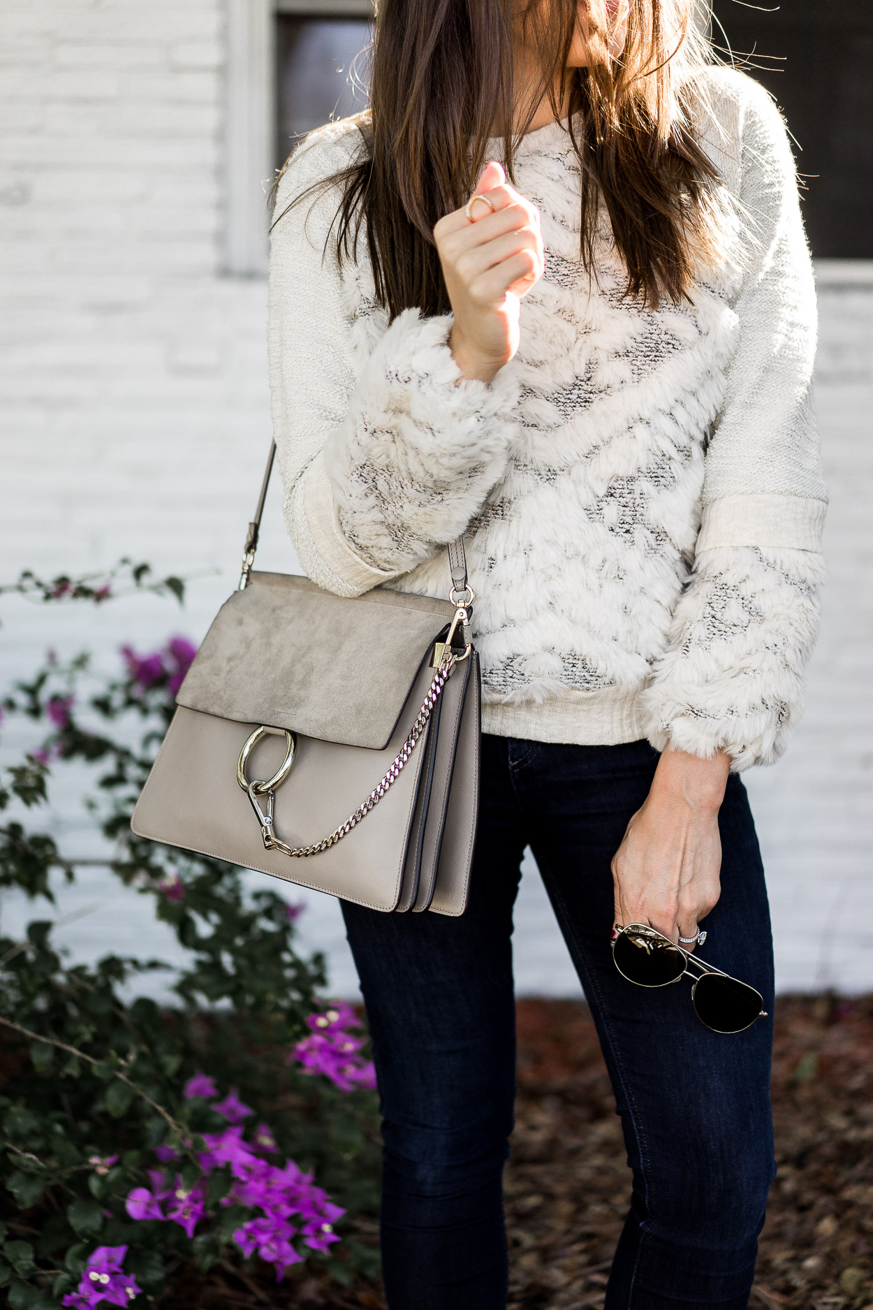 Amanda from A Glam Lifestyle blog wears an Anthropologie textured sweatershirt as one of her fave cozy sweaters