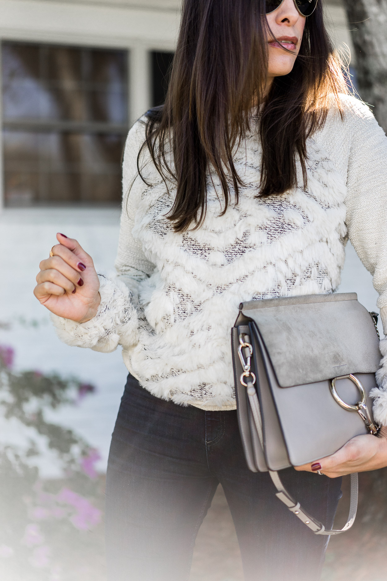 Wear cozy sweaters like this Anthropologie knit like A Glam Lifestyle blogger Amanda