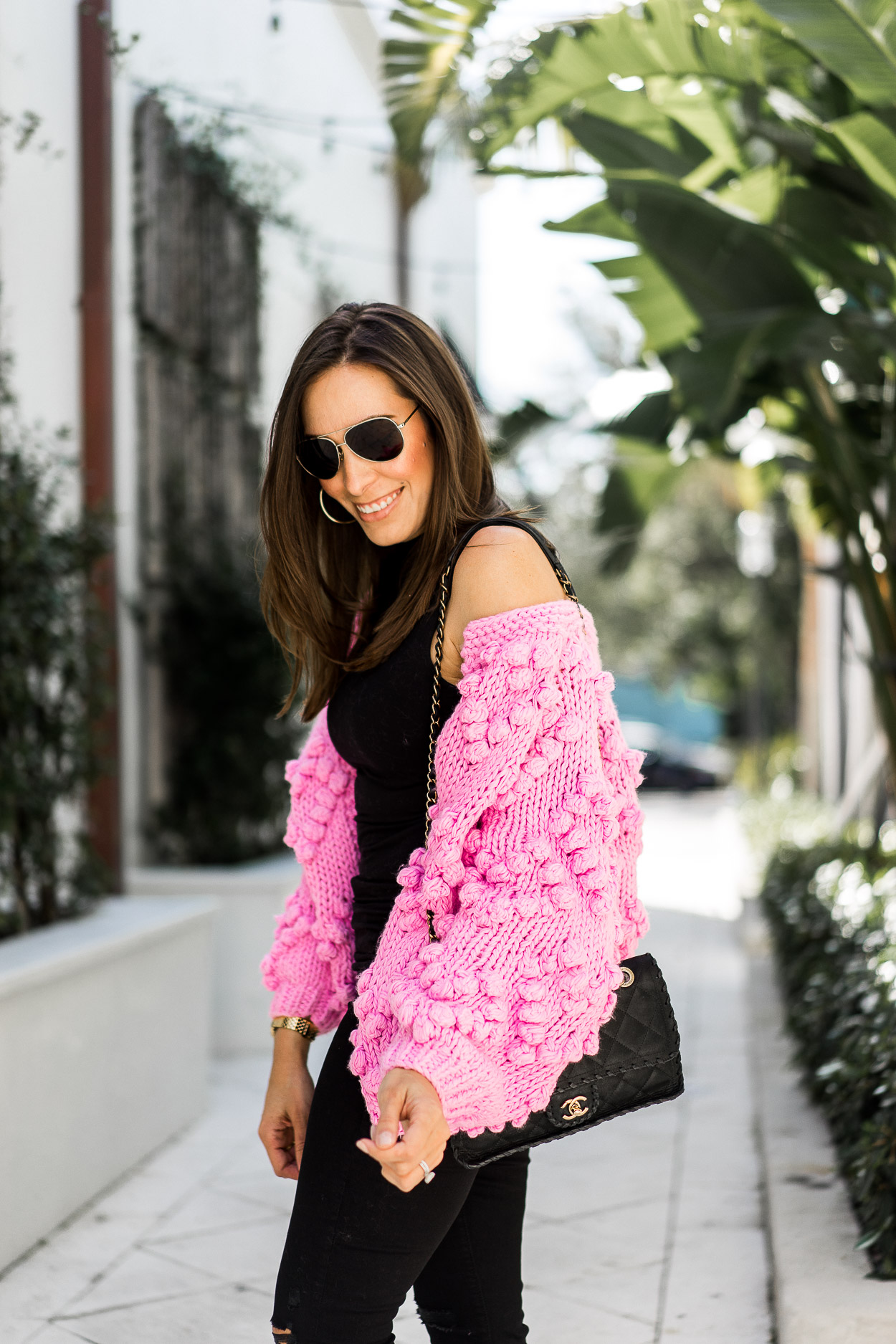 Chic pink pom pom cardigan is casual weekend outfit worn by A Glam Lifestyle blogger Amanda