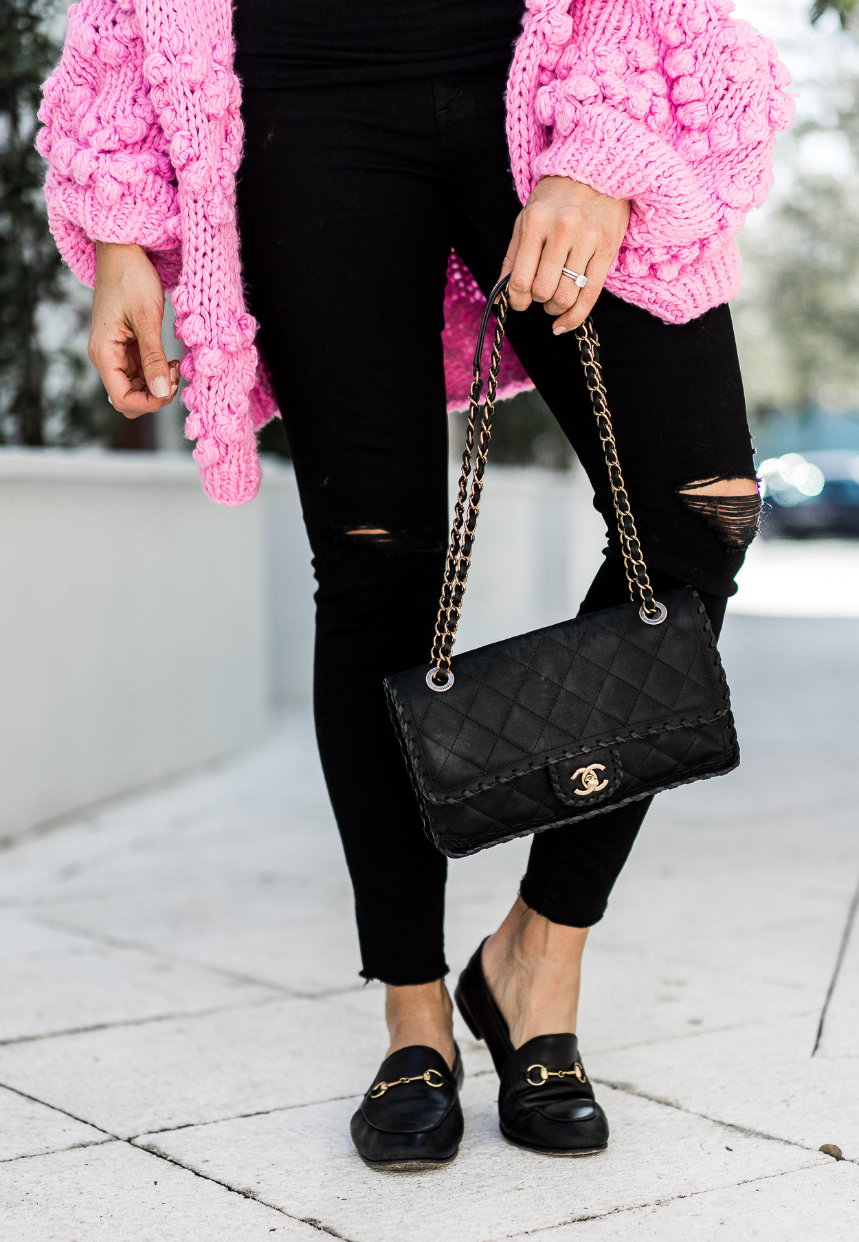 Blogger wears Gucci loafers with pink pom pom sweater and classic Chanel bag