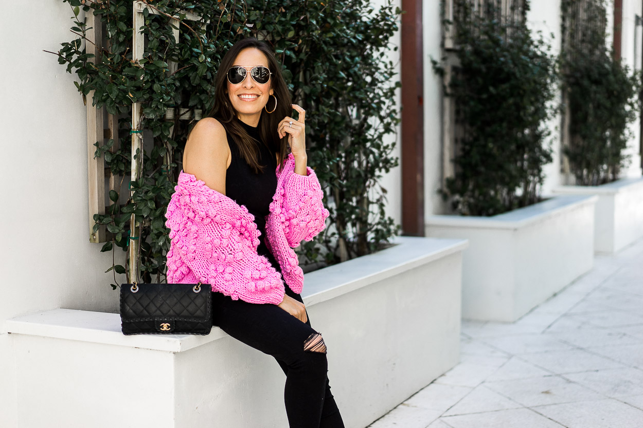 Pink Chicwish pom pom cardigan is perfect Valentine's day look styled by fashion blogger Amanda of A Glam Lifestyle with Mother distressed denim and classic Chanel bag