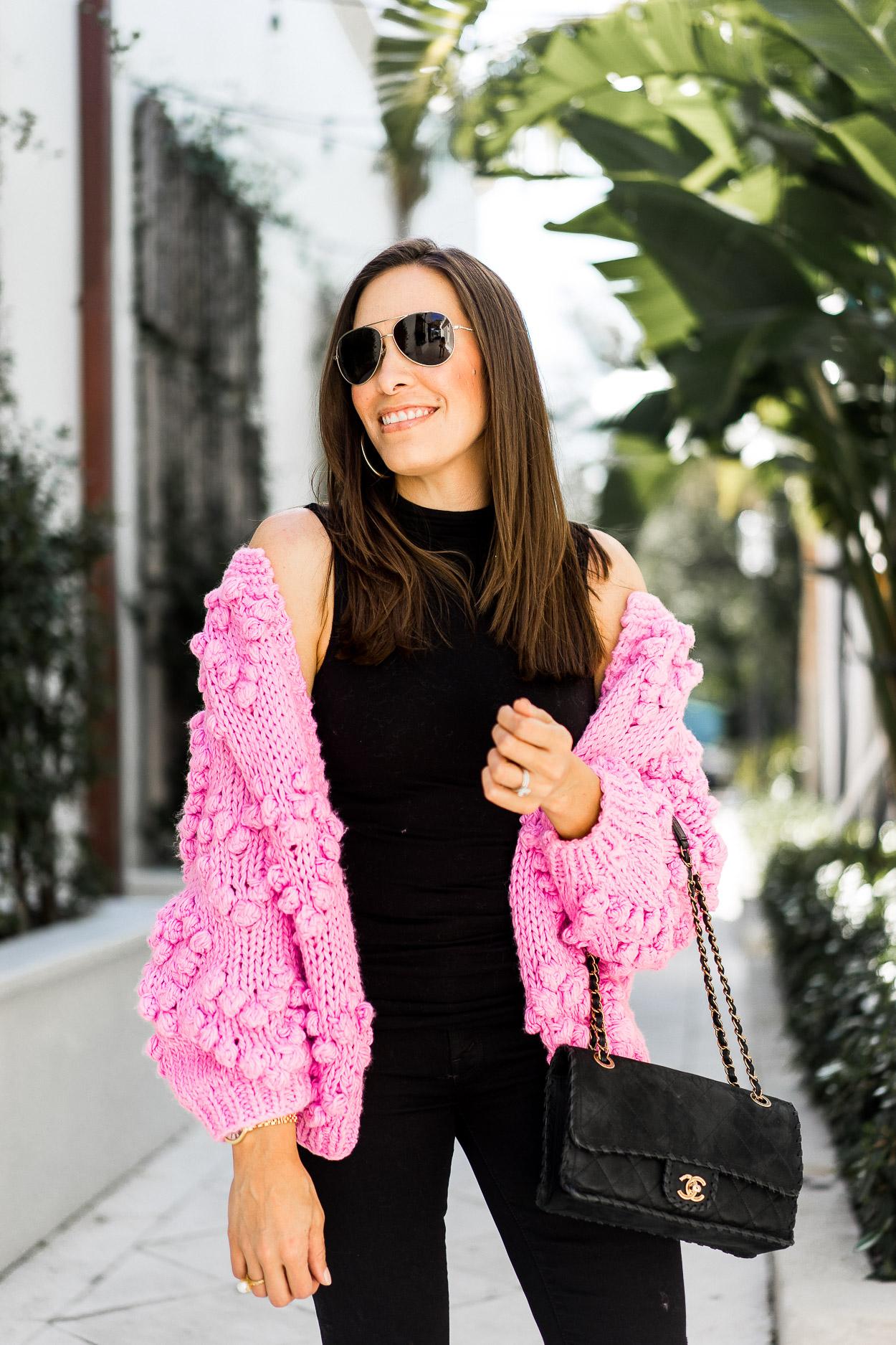Wear a bright pink pom pom cardigan for easy weekend style like fashion blogger Amanda of A Glam Lifestyle