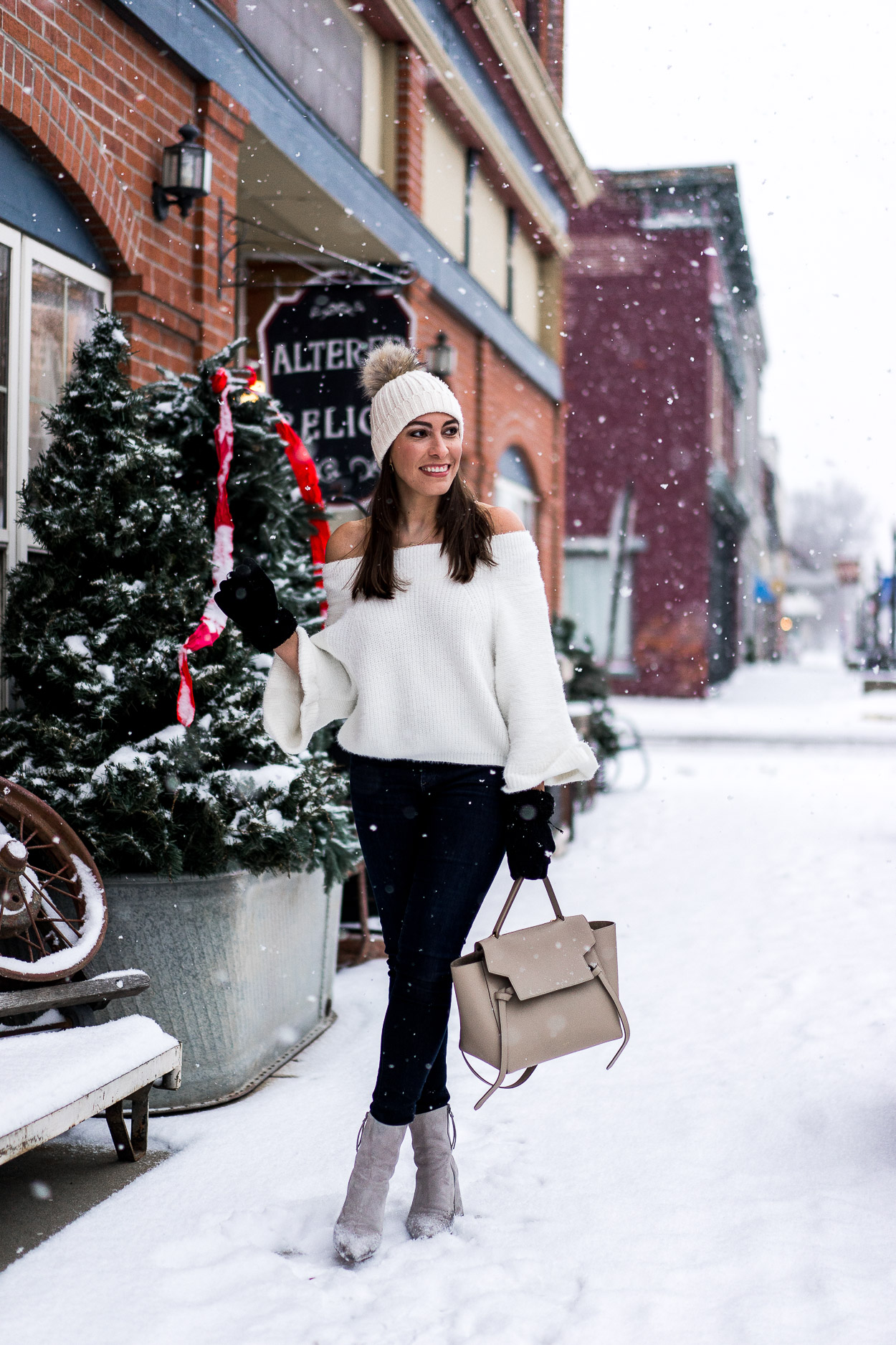 Off the shoulder Chicwish fluffy sweater looks date night ready in the snow styled by Amanda of A Glam Lifestyle blog with nude Celine belt bag and Rag & Bone denim