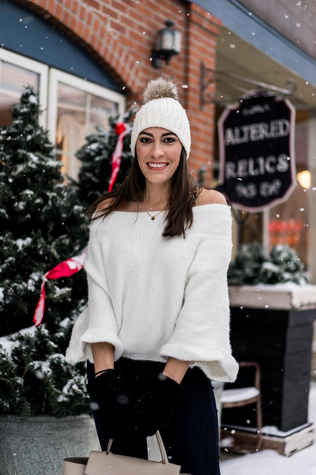 Amanda of A Glam Lifestyle blog wears a Chicwish fluffy sweater with dark denim for a casual date night outfit