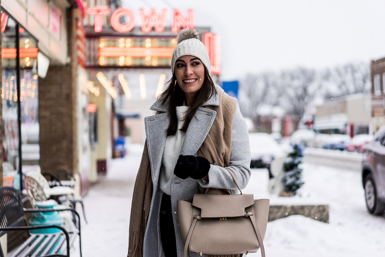Layer your Chicwish fluffy sweater with a grey coat and fringed Free People scarf for a cute winter date night outfit