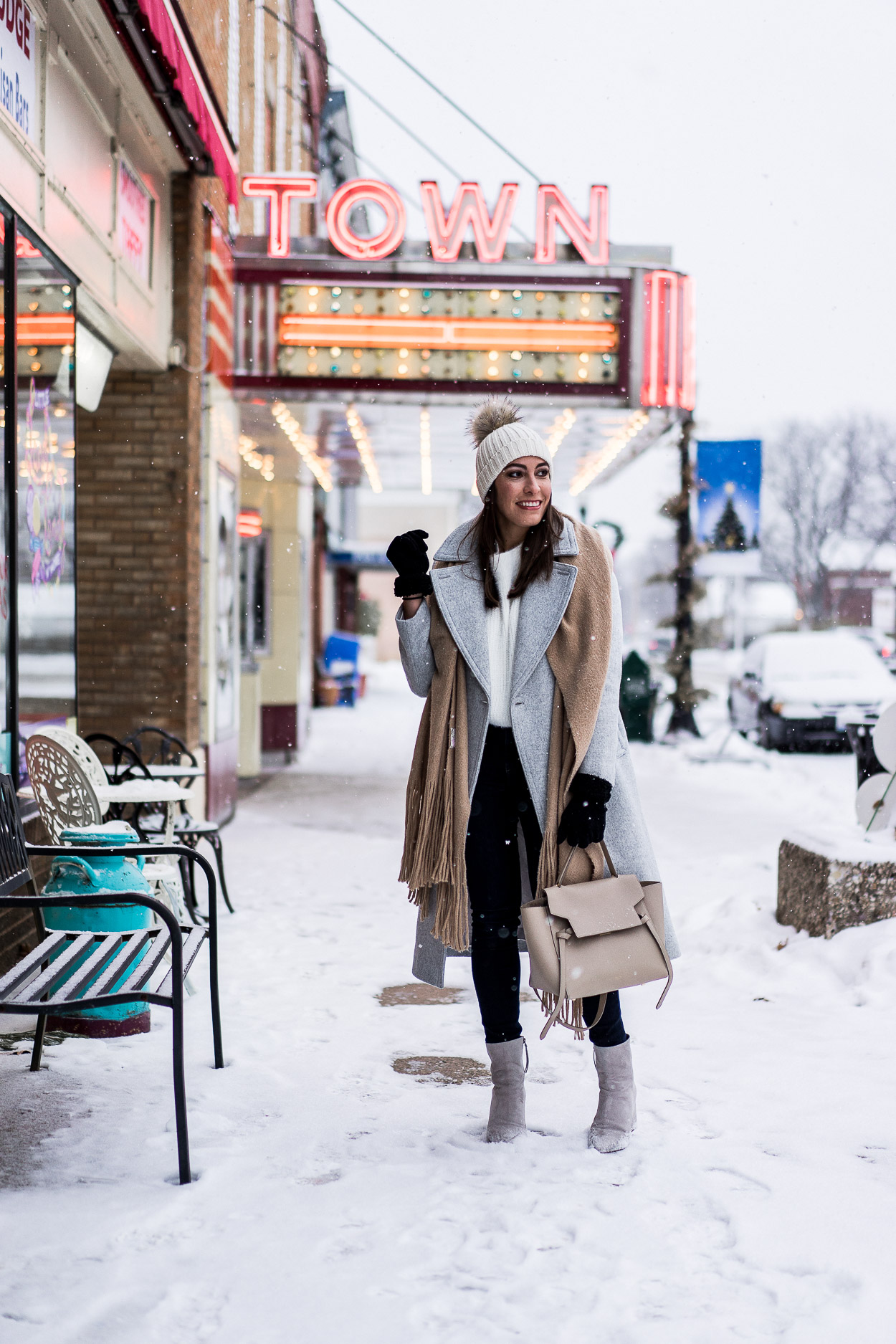 Winter date night outfits include a cozy sweater and chic coat like this one from Club Monaco styled by fashion blogger Amanda