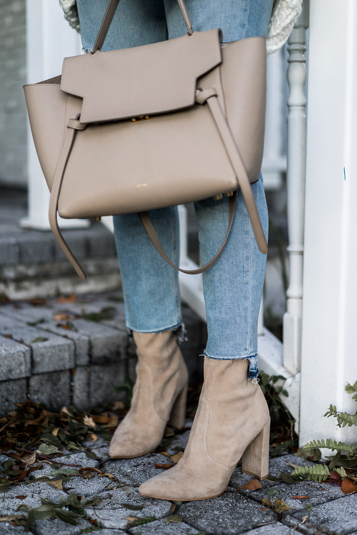 Stuart Weitzman nude Clinger booties are styled with Celine belt bag by fashion blogger Amanda