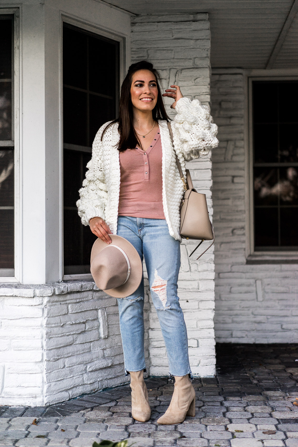 Blogger approved casual chic look starts with a Chicwish white chunky sweater and this Urban Outfitters blush henley tee like Amanda of A Glam Lifestyle blog