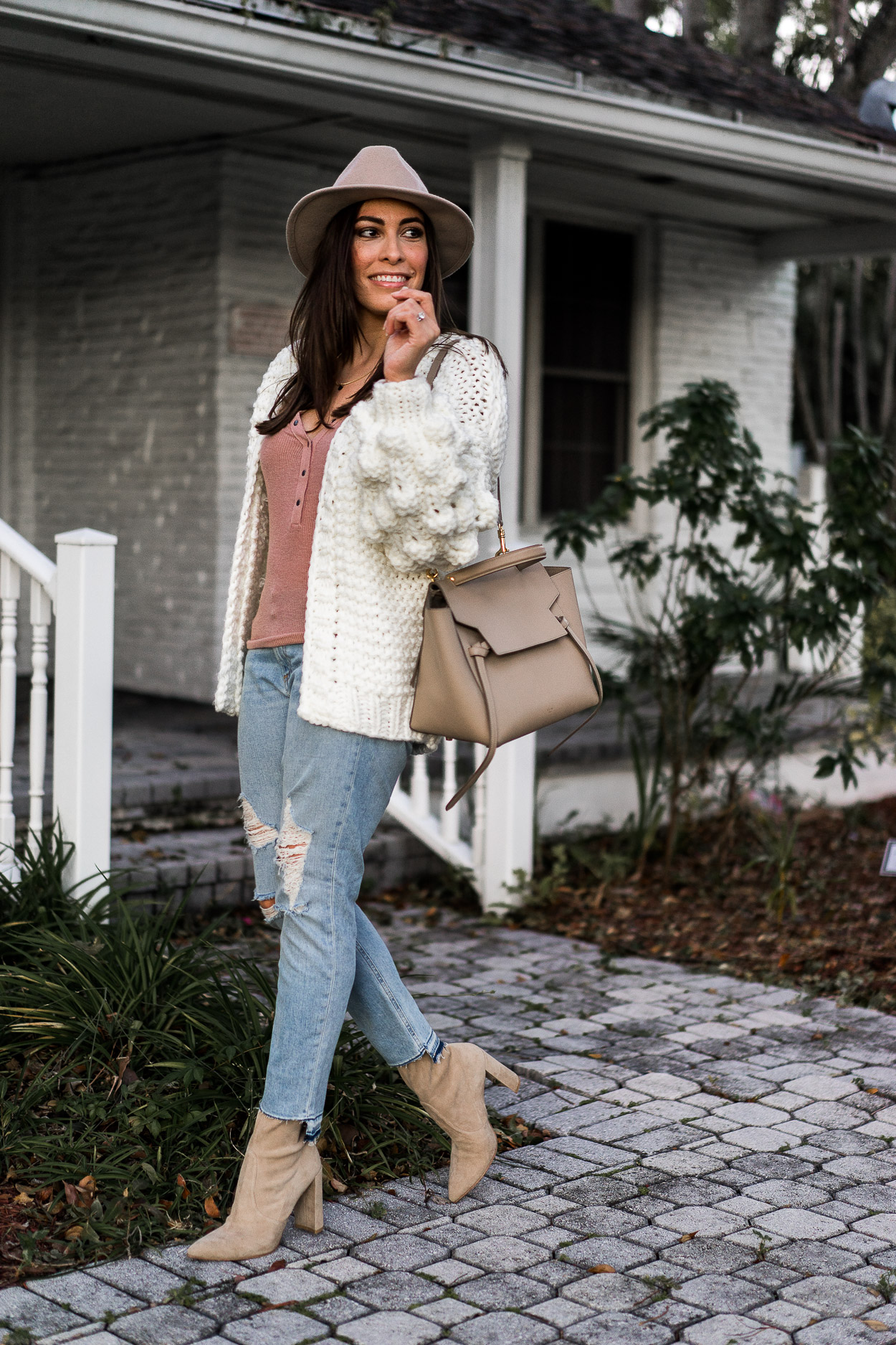 Chicwish white chunky sweater is styled with Rag & Bone denim and stuart Weitzman Clinger booties by Amanda of A Glam Lifestyle blog