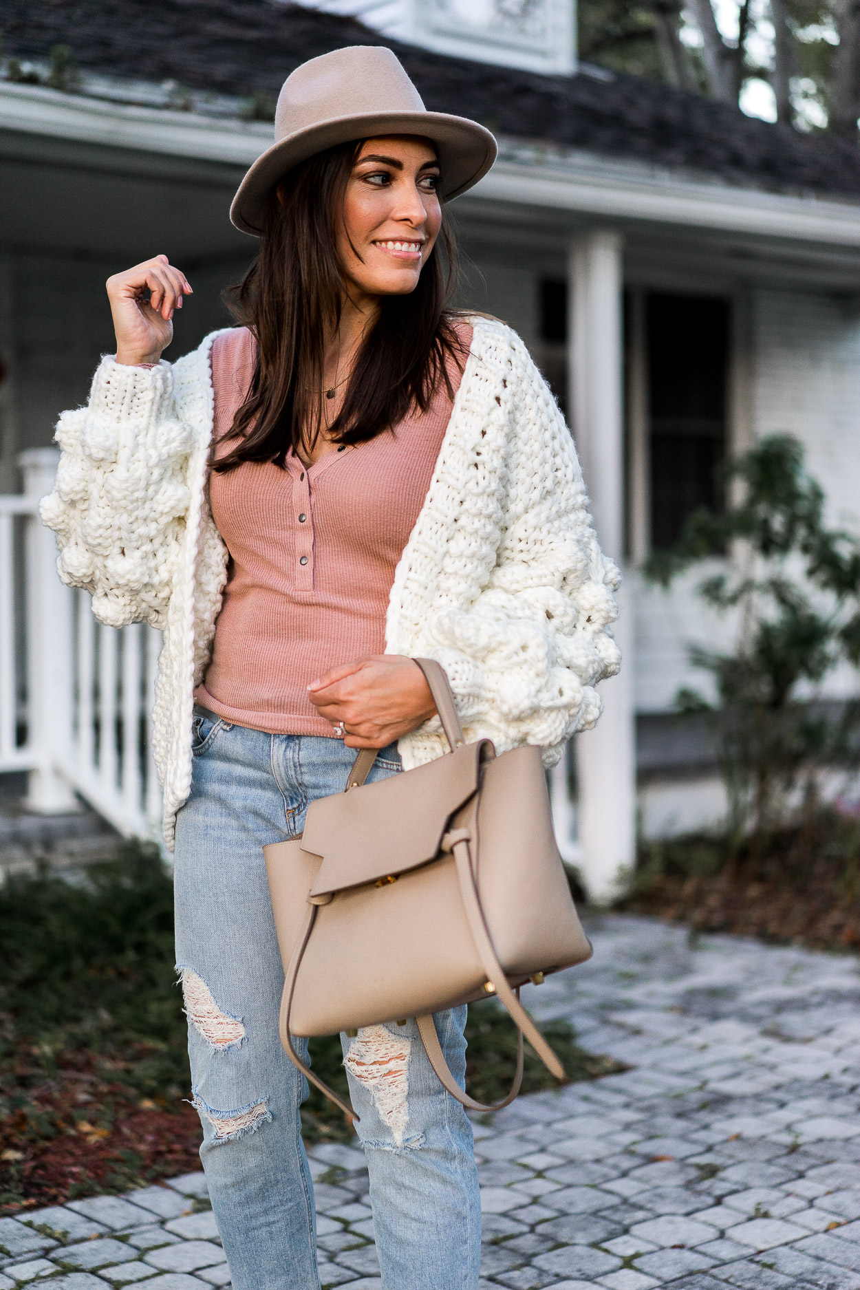 Chicwish white chunky cardigan is chic with a blush henley tee from Urban Outfitters styled by South Florida fashion blogger Amanda of A Glam Lifestyle with her Celine Belt bag