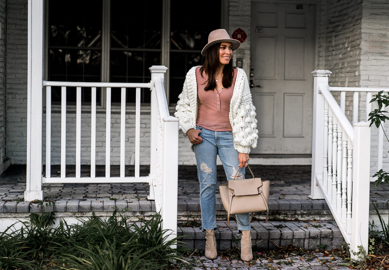 Fashion blogger Amanda wears chic white chunky sweater from Chicwish with her blush henley tee from Urban Outfitters and Stuart Weitzman clinger booties