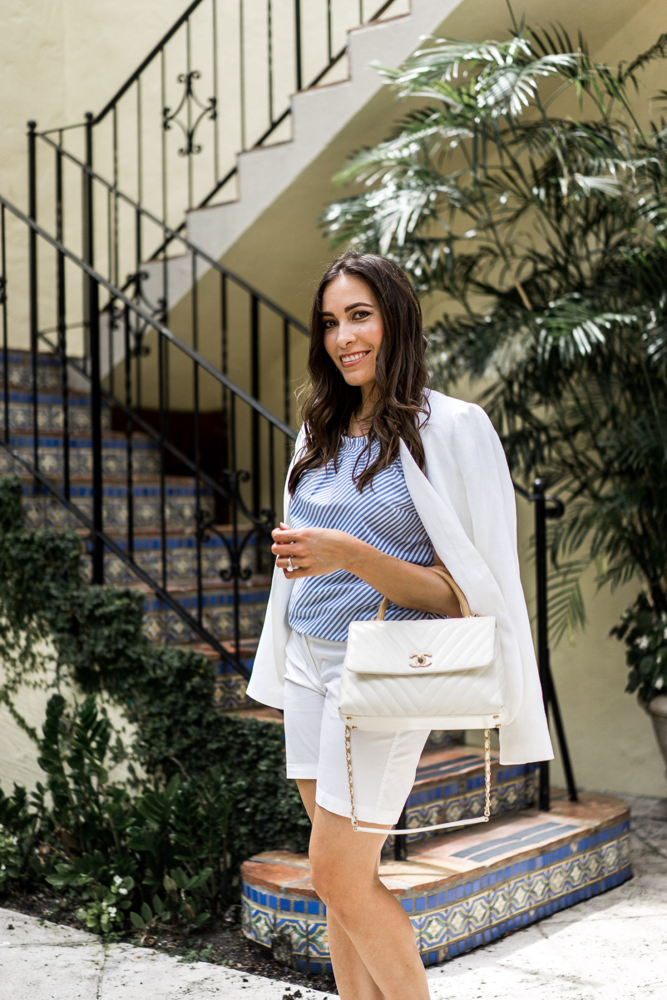 b9e4047b9b2 ... Amanda pairs the Talbots white linen blazer with her striped shell  blouse and girlfriend shorts in ...